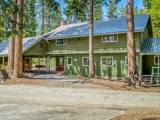 Spacious cabin home w/ a large deck, wood-burning fireplace, & full kitchen