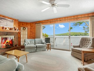 Cozy & spacious waterfront cottage w/ a fireplace, full kitchen, & deck