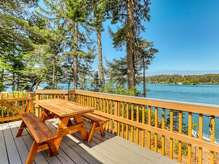 Gorgeous waterfront home with a dock, balcony, & deck - ultimate outdoor living!