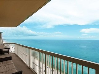 Stylish & spacious waterfront condo w/ a covered balcony, shared pools, & gym