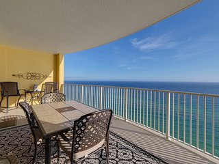 Beach views high rise condo with shared pool and hot tub!