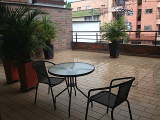 Perfect location, close to everything, awesome apt. with giant patio in Laureles