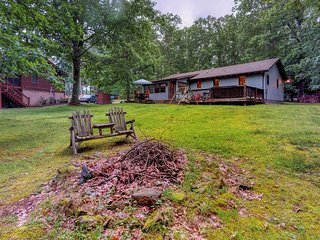 Dog-friendly lake home w/ private hot tub, wood stove, firepit, & furnished deck