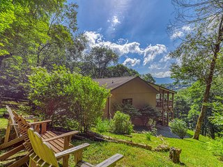 Dog friendly retreat featuring natural light, stone fireplace & private balcony
