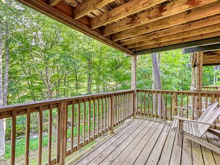 NEW LISTING! All-seasons riverfront log cabin with great views, cozy interior