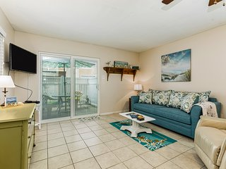 Coastal condo w/ shared pool, private patio, and two-car garage