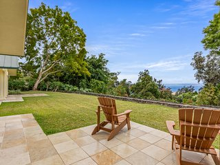 Incredible ocean view home on a hill w/ an enormous patio, firepit, & gas grill