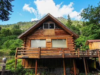 Cozy, dog-friendly cabin w/ a great deck, partial lake views, & beach access