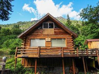 Cozy, dog-friendly cabin w/ a great deck, partial lake views, & beach access