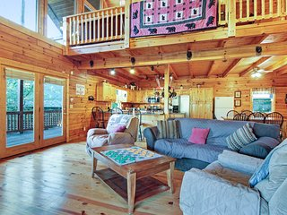Dog-friendly waterfront cabin w/ private hot tub, pool table & dock!