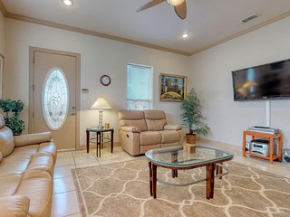 NEW LISTING! Bright island condo w/shared pool, outdoor grill-Close to beach!