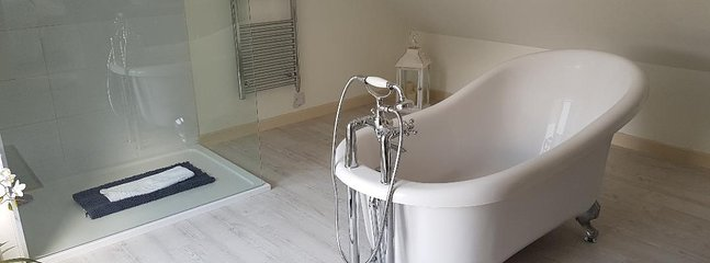 Ensuite bathroom with rolltop bath and large walk in shower