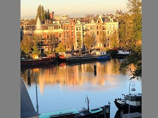 VIEWS OF AMSTEL CANAL FROM THE LUXURY OF YOUR HOME
