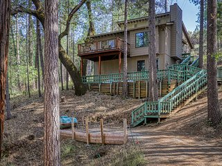 Woodland home w/ deck, shared pool, forest views & onsite golf and lake