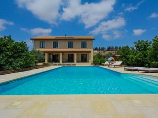 Boutique Stone Villa set in an Orange Grove. Peaceful yet close to everything