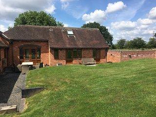 Coach House Farm Stay at Oaks Barn Farm with optional hot spa.