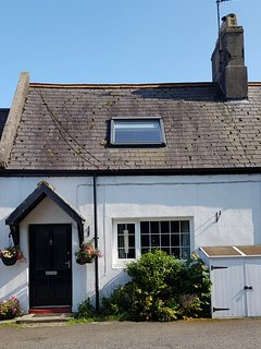 Tickle Cottage facing village green & St Ebbs Church