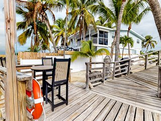 NEW LISTING! Comfy retreat w/ separate cottage, patio, & pier