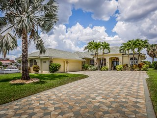 Riverfront home w/ panoramic canal views, private pool/spa & dock!