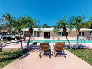 Pet friendly canal side home with pool and boat dock!