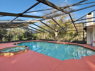 Family-friendly home on an acre w/ a private pool & covered lanai!