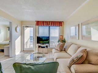 Waterfront condo w/ a furnished balcony, beach views, & shared pool