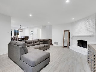 NEW LISTING! Contemporary townhome w/ a full kitchen, patio, & fenced yard!