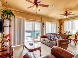 Tranquil lakefront condo with ocean views, shared pool, central AC & free WiFi!