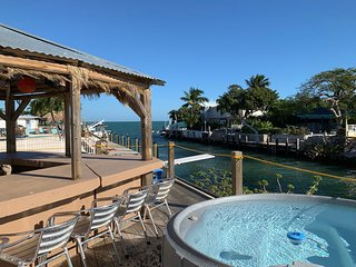 Waterfront home w/ a Tiki hut, private outdoor spa, dock, & amazing Gulf views