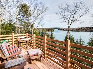 Beautiful riverfront home with a deep water dock & deck!