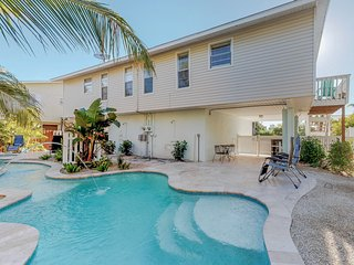 NEW LISTING! Cozy and peaceful duplex w/ canal view and heated pool.