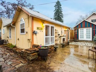 NEW LISTING! Charming home w/ courtyard, fenced yard, & fireplace - near town!