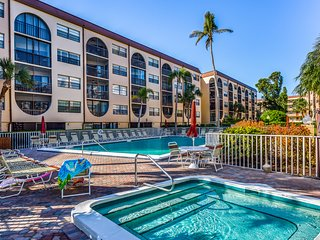 Breezy condo at waterfront property w/ pools, hot tubs, tennis, dock, & Tiki bar