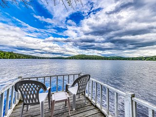 NEW LISTING! Lakefront cottage with screened gazebo, dock, 2 acres of space