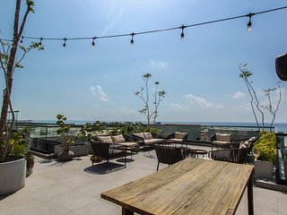 NEW LISTING! Central condo with rooftop patio/pool, nearby shopping & nightlife