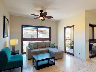 Beautiful condo in beachfront resort with shared infinity pool, security, gym