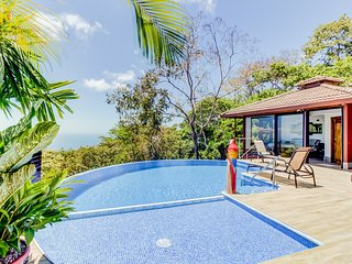 Hillside home w/ ocean view plus private pool, deck, outdoor kitchen & showers