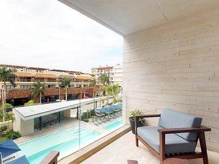 NEW LISTING! Modern condo w/ shared pools, & sundeck - walk to the beach!