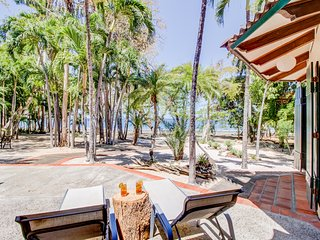 Dreamy, waterfront beach house w/ a full kitchen, furnished patio, & firepit