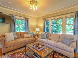 Stunning lakefront legacy home in Green Lake w/game room & wading pool access
