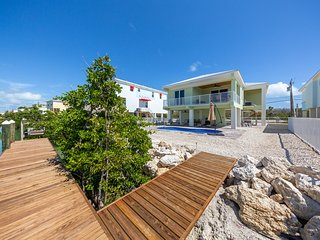 Waterfront home w/ spectacular view, private pool, dock & patio - walk to beach!