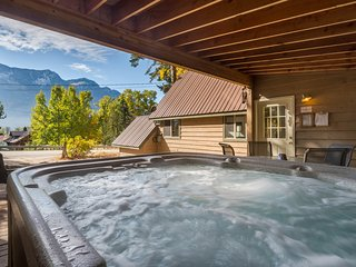 NEW LISTING! Gorgeous chalet with lake & forest views, private hot tub! Dogs ok!