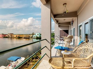 Second-floor condo with great lagoon views from the balcony and shared pool