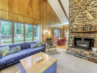 Dog-friendly vacation home w/ a fireplace, furnished deck, & outdoor firepit