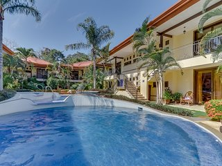Spacious condo w/ a shared outdoor pool  & gated entrance - near the beach