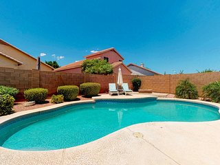 NEW LISTING! Beautiful Chandler home w/ a heated pool, furnished patio, & yard