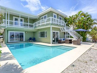 Spectacular Waterfront Home Near Beach!  Private Pool and Boat Dock–Salty Sunris