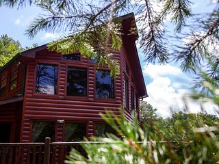 Private set unique log cabin with trails on property