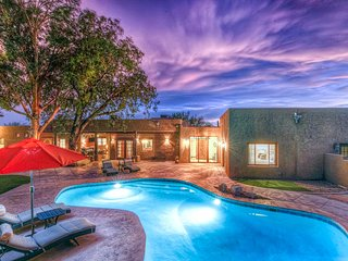 An oasis in the Catalina Foothills on 2.1 acres w/ private pool & putting green!