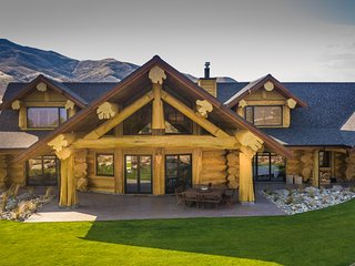 Unique, impressive log home with 5 bedrooms and views of the Clutha River.
